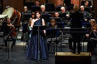 Mezzo-soprano Blythe Gaissert with conductor Ruth Reinhardt, right, and the Dallas Symphony Orchestra, performs a selection from Luciano Berio's Folk Songs in a ReMix concert March 2, 2018 at Moody Performance Hall in Dallas. (Ben Torres/Special Contributor)