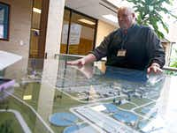 Daniel Halter, plant manager, behind a model of the Central Wastewater Treatment Plant in Dallas on Feb. 16, 2018.(Nathan Hunsinger/Staff Photographer)