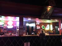 The historic Cain's Ballroom dance hall and concert venue has walls lined with portraits of country greats, including Jimmy Dickens. (Sophia Dembling/Special Contributor)