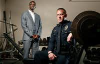 Dr. Akwasi Boah (left) from the Texas Back Institute and police Sgt. Chris Tepfer at the Corinth Police Department's weight room on Feb. 14, 2018. Tepher passed out a day after working out, and Dr. Boah concluded he had an epidural hematoma, a life-threatening injury.(Nathan Hunsinger/Staff Photographer)