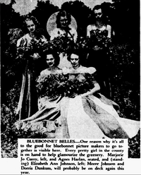 A 1940 image from <i>The Dallas Morning News'</i> archives of a group of girls  dubbed the Bluebonnet Belles, posing in the field of bluebonnets. It was common to see women dressed up to get their picture taken with the flowers.