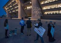 """A slogan reading """"Clean Dream Act"""" is projected on Dallas City Hall during a DACA protest Monday, March 5, 2018.(Rex C Curry/Special Contributor)"""