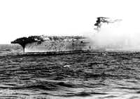 In this 1942 file photo, crew abandons the USS Lexington after the decks of the aircraft carrier sunk in the Battle of the Coral Sea during World War II. The sunken ship was discovered by an expedition funded by Microsoft co-founder Paul Allen on March 4.(AP)