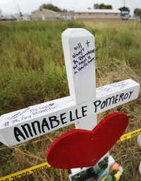 A wooden cross near First Baptist Church in Sutherland Springs honors 14-year-old Annabelle Pomeroy.(Louis DeLuca/Staff Photographer)