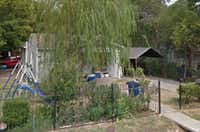 <p>The victim was found dead in a home behind this house on Elwayne Avenue, police say.</p>(<p>(Google Maps)</p>)