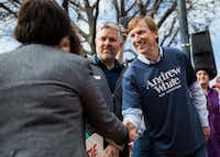 Gubernatorial candidate Andrew White, the son of former Texas Gov. Mark White, shakes hands with former Dallas County sheriff and fellow gubernatorial candidate Lupe Valdez as they are recognized before  the Austin Women's March on Jan. 20, 2018, in Austin.(Ashley Landis/Staff Photographer)