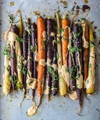 Roasted Sesame Ginger Carrots with Spicy Tahini and Carrot Greens (Rebecca White/Special Contributor)