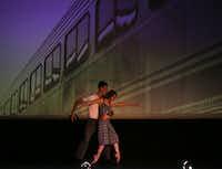Lea Zablocki and Michael Stone in Dallas Neo-Classical Ballet's <i>Revenir</i> at the Texas Theatre.(Rose Baca/Staff Photographer)