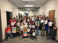 Approximately 40 parents and students showed up at a Mansfield ISD board meeting to speak in support of Charlotte Anderson Elementary School art teacher Stacy Bailey.(Florence Salazar Bruner)