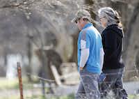 Mark Morris, father of Christina Morris, walked with Marietta Schell on her property as police investigated skeletal remains found nearby. (Vernon Bryant/Staff Photographer)