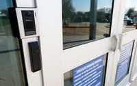 A camera at the main entrance at McKinney North High School in McKinney on Monday.(Vernon Bryant/Staff Photographer)