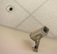 New camera on the ceiling next to one of the older models in a hallway at McKinney North High School in McKinney on Monday.(Vernon Bryant/Staff Photographer)