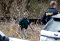 A Plano police officer walked out of the scene where human remains were found near the intersection of Taylor Boulevard and Mesquite Lane in Anna on Thursday, March 8, 2018. (Jae S. Lee/Staff Photographer)