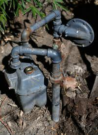 A gas meter is detached from an old gas pipe in the backyard of Elodia Gutierrez's house on Espanola Drive in Dallas.(Jae S. Lee/Staff Photographer)