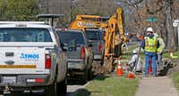 Construction crews work on gas lines on El Centro Drive in northwest Dallas.(Jae S. Lee/Staff Photographer)