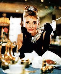 "Actress Audrey Hepburn wears the black dress that she made famous in the 1961 film, ""Breakfast at Tiffany's."""
