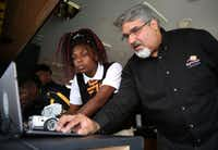 Karim Virani, director of technology for Big Thought helps eighth-grader India Anderson at the Dallas City of Learning Mobile Tech XPerience, which offers STEM-related activities, at Billy Earl Dade Middle School in Dallas on Sept. 8, 2016.  (Rose Baca/The Dallas Morning News)