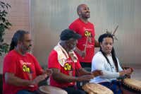 Tony Browne (standing), director of Bandan Koro African Drum and Dance Ensemble, rehearses with his fellow drummers at Sammons Center for the Arts. They perform as part of the Elevator Project this month.(Allison Slomowitz/Special Contributor)