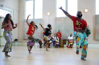 Bandan Koro African Drum and Dance Ensemble artistic lead Diata Brazelton (right) rehearses with the cast of <i>Guinea Fare: Her Story, Her Ipseity </i>at Sammons Center for the Arts.(Allison Slomowitz/Special Contributor)