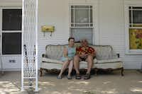 Johnny Rincon and his wife, Sarah, sit on the porch of their rented home on Harry Hines Boulevard, in the Dallas neighborhood formerly known as Little Mexico on Sept. 5, 2014. Johnny Rincon grew up in the neighborhood and is one of the last remaining original residents. (Jim Tuttle/The Dallas Morning News) (Jim Tuttle/Staff Photographer)