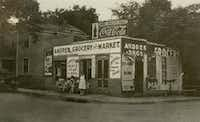 CREDIT: Dallas Jewish Historical Society // Andres Grocery and Market in 1918 on Pearl Street with Andres family outside store.  [ Little Mexico in Dallas ] (Unknown/Courtesy of DJHS)