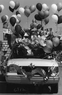March 17, 1990: Kids wave while riding in the Greenville Avenue parade.(Richard Michael Pruitt/The Dallas Morning News)