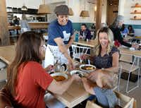 Julie Williams, co-founder of Taste Project at Taste Community Restaurant in Fort Worth, serves Angela Callaway, from left, Lisa Gerhard, right, and her son, Rowan Gerhard of Mansfield during lunch on March 8, 2018. (David Woo/Staff Photographer)