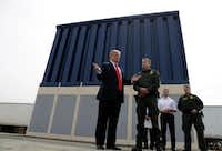 President Donald Trump reviews border wall prototypes on March 13 in San Diego.(Evan Vucci/The Associated Press)