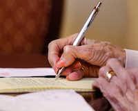 Gloria Box, a senior resident at Presbyterian Village North in Dallas writes a letter in cursive to Olivia Tomaselli, a third-grade student at Good Shepherd Episcopal School (David Woo/The Dallas Morning News)