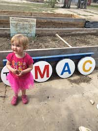 Kara Wigzell, 2, of Dallas at The MAC POP Garden open house.(Nancy Churnin)