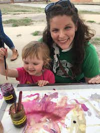 Kara Wigzell, 2, and her mother, Katie O'Brien, of Dallas paint with natural dyes.(Nancy Churnin)