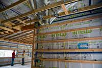 Ductwork and lighting in progress at the house. (Ashley Landis/Staff Photographer)