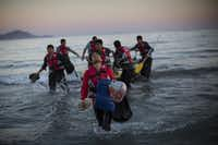 Migrants from Pakistan land on shore after completing a journey in a small dinghy crossing a three mile stretch of the Aegean Sea from Turkey August 31, 2015 in Kos, Greece. Migrants from many parts of the Middle East and African nations continue to flood into Europe before heading from Athens, north to the Macedonian border. The number of people leaving their homes in war torn countries such as Syria, marks the largest migration of people since World War II.(Dan Kitwood/Getty Images)
