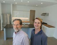 Kyle Fagin, left, and son Connor Fagin, owners of Fagin Partners, in the kitchen of the recently finished passive house in Dallas.(Ron Baselice/Staff Photographer)