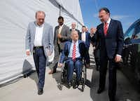 Luis Miguel Monroy Carillo (from left) talks with Govenor Greg Abbott  along with Secretary of Foreign Affairs Luis Videgaray caso during a tour at the grand opening at La Moderna in Cleburne.(Nathan Hunsinger/Staff Photographer)