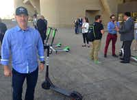 Matt Shaw, Bird's director of government relations, offered free rides on his company's electric scooters in front of Dallas City Hall on Wednesday.(Robert Wilonsky/Staff writer)