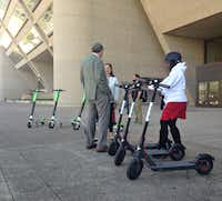 City employees took rides on electric scooters Wednesday.(Robert Wilonsky/Staff writer)
