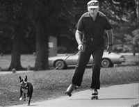 A man enjoying nature while rollerskating with his dog in 1981.(The Dallas Morning News)