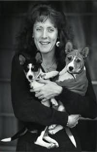 Kathy Brewer holds two Basenji pups in 1989.(John F. Rhodes/The Dallas Morning News)