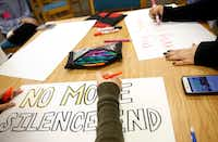 Students made signs for the March for Our Lives rally at Irving High School on Tuesday. In support of the Parkland, Fla., community, the group of students and teachers plan on marching from the Irving DART station to Dallas on Saturday.(Tom Fox/Staff Photographer)