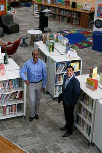 "The Coppell school board soon will have its first Indian American trustee — either Balkishore ""Balki"" Chamkura (left) or Manish Sethi. On Monday, they posed in the library of Richard J. Lee Elementary near DFW Airport.(Nathan Hunsinger/Staff Photographer)"