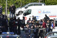 French security and police gather outside the Super U supermarket in the town of Trebes in France.(PASCAL PAVANI/AFP/Getty Images)