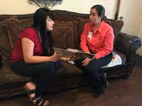 <p></p><p>Alejandra Camarillo (left) goes over a reading activity with HIPPY instructor Abigail Ponce. </p><p></p>(Elvia Limon/Staff)