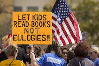 """A sign reads """"Let kids read books not eulogies!!"""" in reference to recent school shootings.(Smiley N. Pool/Staff Photographer)"""