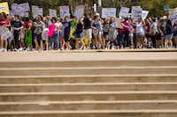 Demonstrators form up toward the end of the line as the march slowly begins on the steps of City Hall.(Smiley N. Pool/Staff Photographer)
