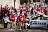 Dallas police block traffic as demonstrators march down Young Street near City Hall.(Smiley N. Pool/Staff Photographer)
