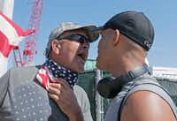 """<p><span style=""""font-size: 1em; background-color: transparent;"""">A gun-rights advocate (left) exchanges heated words with demonstrator </span><a name=""""firsthit"""" id=""""firsthit"""" draggable=""""false"""" style=""""font-size: 1em; background-color: transparent;""""></a><span style=""""font-size: 1em; background-color: transparent;"""">Eric Cauley as Cauley took part in the March For Our Lives in West Palm Beach, Fla.</span></p>(Joe Skipper/The Associated Press)"""