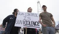 "<p><span style=""font-size: 1em; background-color: transparent;"">Pro-guns advocates offer their view on the guns debate during the March for Our Lives in Oklahoma City. </span></p>(J. Pat Carter/Getty Images)"