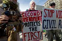 "Pro-gun demonstrators protest during the ""March for Our Lives"" rally in support of gun control in Washington on Pennsylvania Avenue near the U.S. Capitol.(Jose Luis Magana/The Associated Press)"