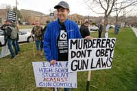 "<p><span style=""font-size: 1em; background-color: transparent;"">Levi Rodas, 16, from Orem High School, was among those demonstrating against stronger gun control measures Saturday in Salt Lake City. </span></p>(Rick Bowmer/The Associated Press)"